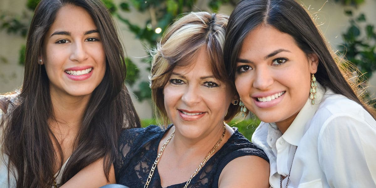 Woman with daughters smiling